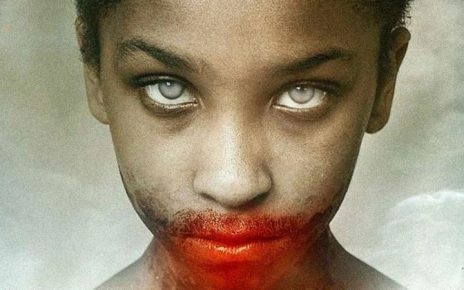 A young girl with a bloody mouth